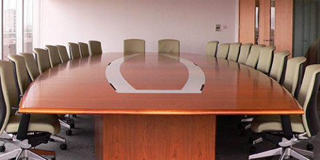 Bespoke cherry Boardroom table with glass raceway for cable management