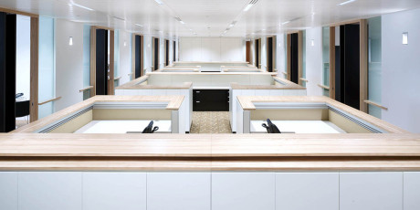 Bespoke open plan cupboards linked to workstations