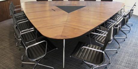 Bespoke-plectrum-shaped-meeting-table-in-walnut_WEB